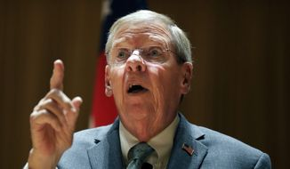 In this Aug. 14, 2017, file photo, Sen. Johnny Isakson, R-Ga., speaks during a town hall meeting at Kennesaw State University in, Kennesaw, Ga. (AP Photo/David Goldman, File)