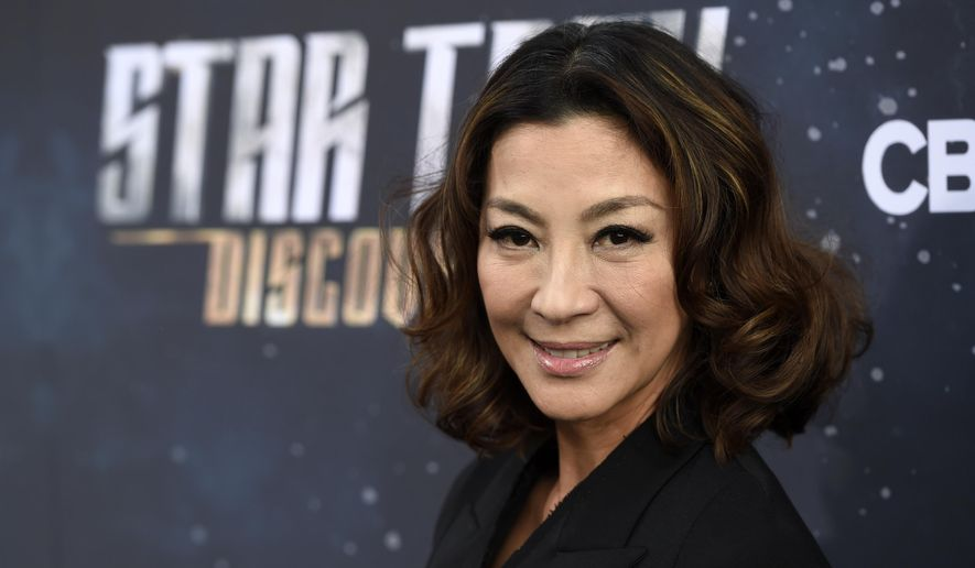 """In this Sept. 19, 2017, file photo, Michelle Yeoh, a cast member in """"Star Trek: Discovery,"""" poses at the premiere of the new television series, in Los Angeles. The Malaysian film star commented Tuesday, Oct. 17, 2017, in a statement to The Associated Press on the sexual harassment scandal surrounding Harvey Weinstein. (Photo by Chris Pizzello/Invision/AP, File)"""