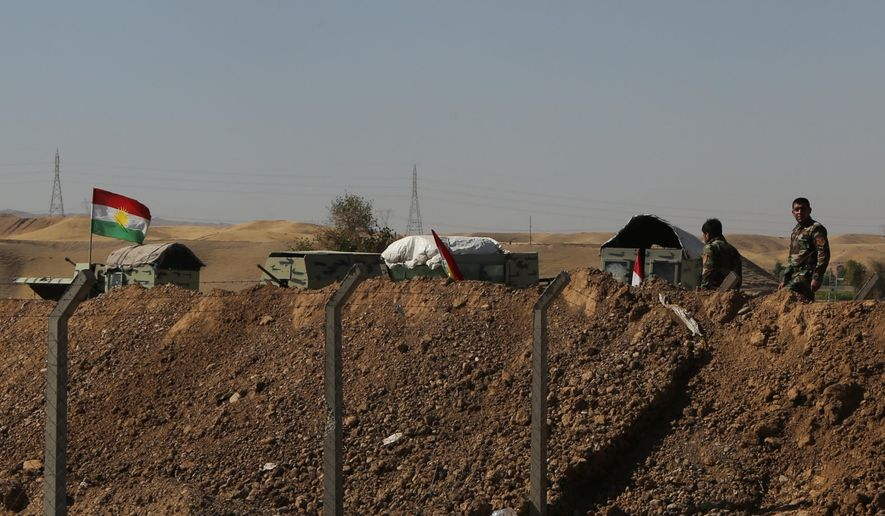 Kurdish security forces stand guard in defensive positions on the outskirts of Irbil, Iraq, Tuesday, Oct. 17, 2017. Kurdish forces lost more territory in Iraq on Tuesday, withdrawing from the town of Sinjar a day after Iraqi forces pushed them out of the disputed city of Kirkuk. (AP Photo/Khalid Mohammed)