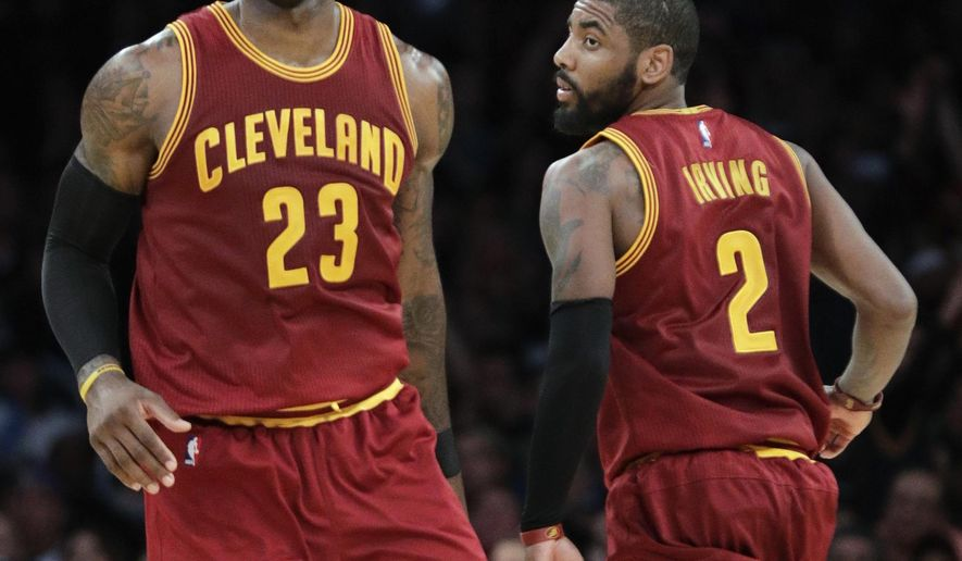 FILE - In this March 19, 2017, file photo, Cleveland Cavaliers' LeBron James, left, greets Kyrie Irving during the second half of an NBA basketball game against the Los Angeles Lakers in Los Angeles. Irving was traded to the Bostons Celtics and returns to Cleveland to play against the Cavaliers, on Tuesday, Oct. 17. (AP Photo/Jae C. Hong, File)