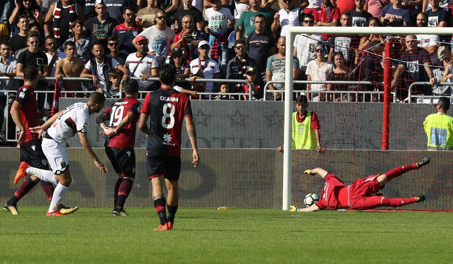 Genoa's Adel Taarabt, left, scores during the Serie A soccer match between Cagliari and Genoa, in Cagliari, Italy, Sunday, Oct. 15, 2017. (Fabio Murru/ANSA via AP)
