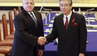 U.S. Deputy Secretary of State John Sullivan, left, and Japan's Deputy Minister of Foreign Affairs Shinsuke Sugiyama shake hands prior to their bilateral meeting at Iikura Guest House in Tokyo Tuesday, Oct. 17, 2017. (AP Photo/Eugene Hoshiko)