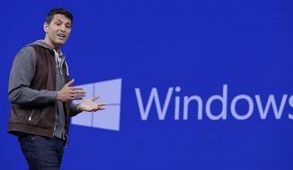 FILE - In this Thursday, May 11, 2017, file photo, Terry Myerson, executive vice president of the Windows and Devices Group, speaks at the Microsoft Build 2017 developers conference, in Seattle. Microsoft has begun rolling out an update to its Windows 10 operating system, hoping to spark enthusiasm for the company's ambitions in virtual and augmented reality. The Windows 10 update became available Tuesday, Oct. 17, 2017. (AP Photo/Elaine Thompson, File)