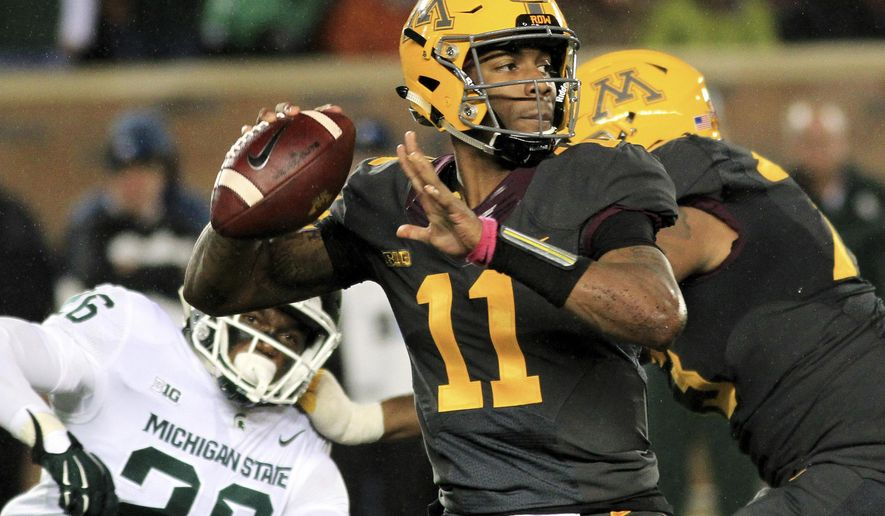 FILE - In this Saturday, Oct. 14, 2017, file photo, Minnesota quarterback Demry Croft (11) looks to pass against Michigan State during the third quarter of an NCAA college football game in Minneapolis. Croft, who was suspended from the team for three weeks last month, returned with a flourish with three fourth-quarter touchdown passes in a rally against Michigan State that fell three points and a few minutes short. (AP Photo/Andy Clayton-King, File)