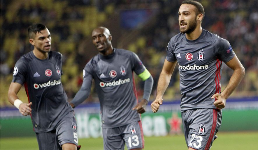 Besiktas' Cenk Tosun, right, celebrates his side's first goal with his teammates during the Champions League Group G first leg soccer match between Monaco and Besiktas at Louis II stadium in Monaco, Tuesday, Oct. 17, 2017. (AP Photo/Claude Paris)