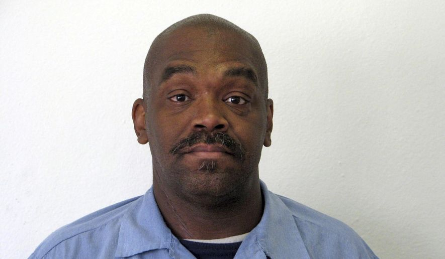 This undated photo provided by the Oregon Department of Corrections shows Jesse Johnson. Johnson is on Oregon's death row after being convicted of murdering a woman in 1998, yet his DNA wasn't on any of the tested evidence related to the murder, and he says he's innocent. Now, a judge is considering whether to allow modern DNA tests, which Johnson's attorneys say could lead to the real killer and exonerate Johnson. (Oregon Department of Corrections via AP)
