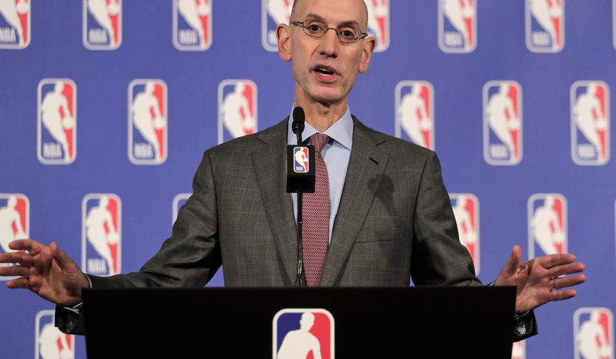 "FILE - In this Sept. 28, 2017, file photo, NBA Commissioner Adam Silver speaks during a news conference in New York. Silver's NBA has had a frenetic offseason filled with more drama than the games themselves, particularly regular season contests. A fourth straight year of the same NBA Finals matchup seems likely, and even Michael Jordan was quoted as saying he fears an NBA where 28 teams are going to be ""garbage."" (AP Photo/Julie Jacobson)"