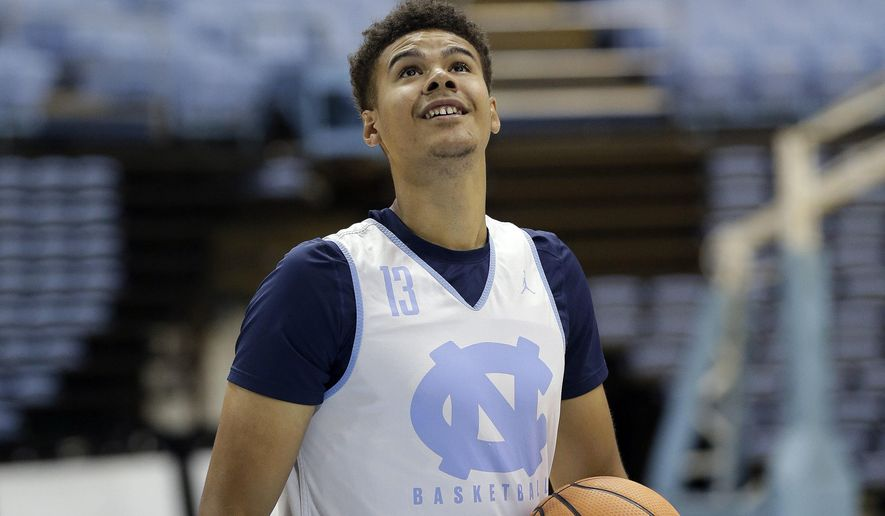 North Carolina's Cameron Johnson tosses a ball during practice following the school's NCAA college basketball media day in Chapel Hill, N.C., Tuesday, Oct. 17, 2017. (AP Photo/Gerry Broome)