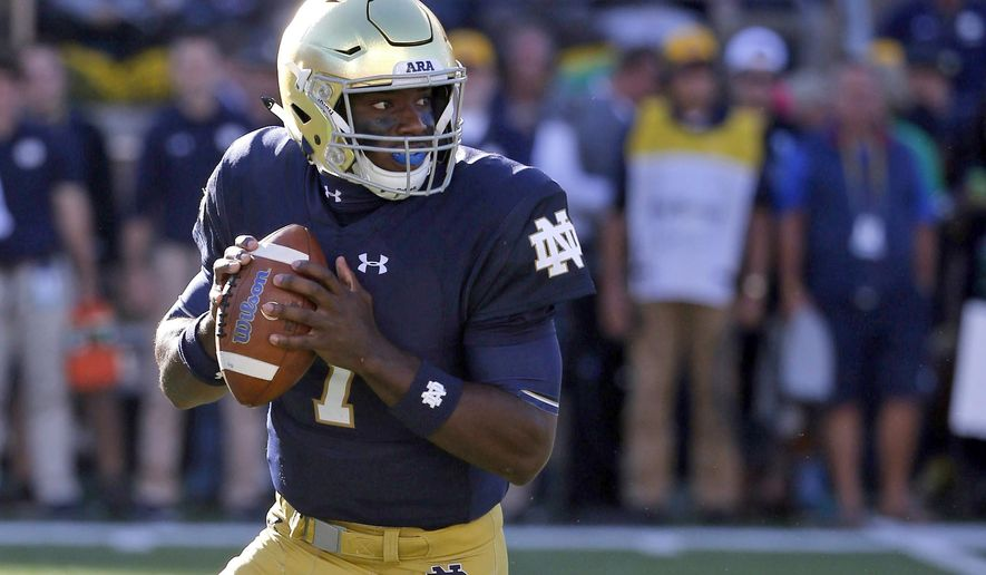 "FILE - In this Sept. 30, 2017, file photo, Notre Dame quarterback Brandon Wimbush rolls out to pass during the first half of an NCAA college football game against Miami (Ohio) in South Bend, Ind. Notre Dame will have Wimbush ready for Saturday's home game against No. 11 Southern California. Coach Brian Kelley says Wimbush is ""100 percent"" after missing the win over North Carolina two weeks ago because of a foot injury.  (AP Photo/Charles Rex Arbogast, File)"