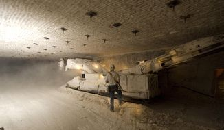 This undated photo provided by the U.S. Department of Energy show a continuous miner performing mining activities in the Waste Isolation Pilot Plant near Carlsbad, N.M. The U.S. Energy Department announced Tuesday, Oct. 17, 2017,  that the work to carve out more disposal space from the ancient salt formation where the Waste Isolation Pilot Plant is located will begin later this fall. The work should be done in 2020.   (David X. Tejada/U.S. Department of Energy via AP)