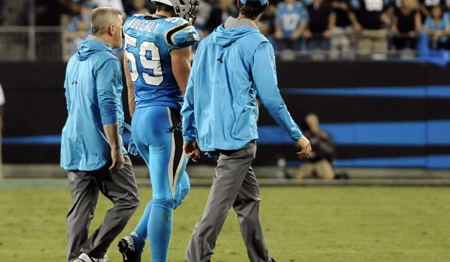 FILE - In this Oct. 12, 2017, file photo, Carolina Panthers' Luke Kuechly (59) is helped off the field after being injured in the first half of an NFL football game against the Philadelphia Eagles in Charlotte, N.C. For the third time in three years, the Panthers have to find a way to replace Luke Kuechly because of a concussion. Only this time, they don't have A.J. Klein to turn to. He signed with the Saints as a free agent meaning its David Mayo's turn to anchor the defense. (AP Photo/Mike McCarn, File)