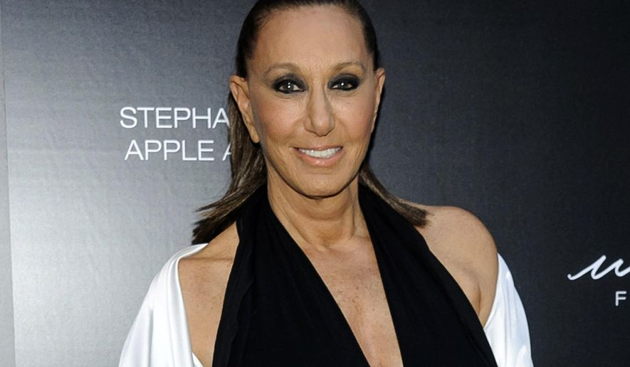 """FILE - In this June 7, 2017 file photo, Donna Karan attends the 2017 Urban Zen Stephan Weiss Apple Awards in New York. Karan says she is apologetic and embarrassed about the remarks she made last week that suggested sexual harassment victims were """"asking for it"""" by the way they dressed. Her comments on a red carpet touched off outrage online in wake of allegations against fallen mogul Harvey Weinstein. (Photo by Christopher Smith/Invision/AP, File)"""