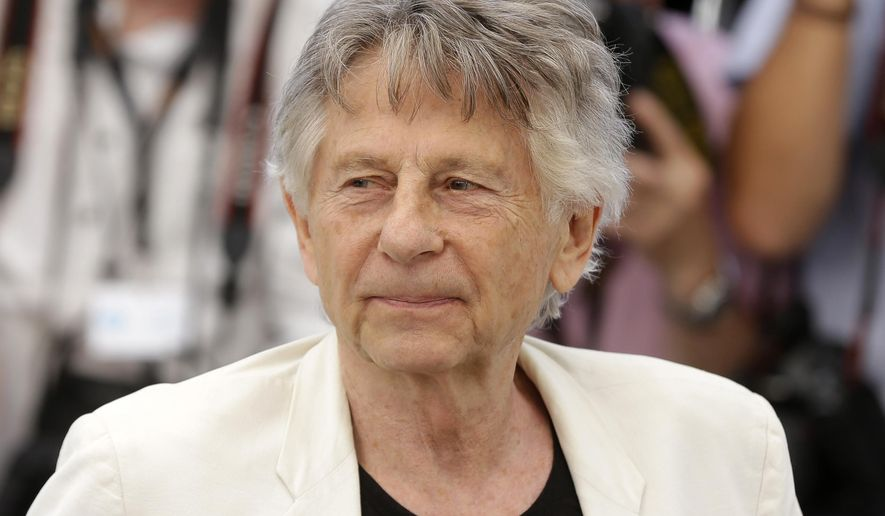 "FILE - In this May 27, 2017 photo, director Roman Polanski appears at the photo call for the film, ""Based On A True Story,"" at the 70th international film festival, Cannes, southern France. A film company said Tuesday, Oct. 17, 2017, Oscar-winning director Roman Polanski is in Poland to appear in a documentary about his early life. (AP Photo/Alastair Grant, File)"