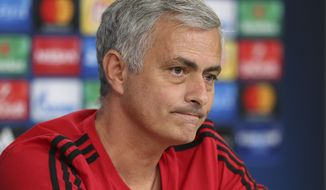Manchester United coach Jose Mourinho listens to questions during a news conference at Benfica's Luz stadium in Lisbon, Tuesday, Oct. 17, 2017. Manchester United will face Benfica Wednesday in a Champions League group A soccer match. (AP Photo/Armando Franca)