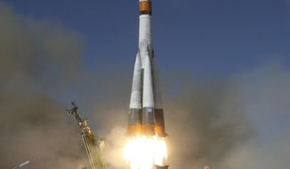 In this photo distributed by Roscosmos Space Agency Press Service, Russian cargo ship Souz 2,1A launches from Russia's main space facility in Baikonur, Kazakhstan, Saturday, Oct. 14, 2017. A Russian cargo ship has been launched to take supplies to the six astronauts aboard the International Space Station. (Roscosmos Space Agency Press Service photo via AP)