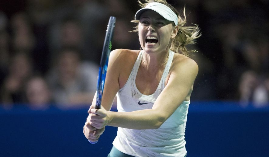 Russia's Maria Sharapova plays a return during the first round match against Slovakia's Magdalena Rybarikova at the Kremlin Cup tennis tournament in Moscow, Russia, Tuesday, Oct. 17, 2017. Sharapova returned in April from a 15-month doping ban and won her first title of the season last week in Tianjin, China. (AP Photo/Alexander Zemlianichenko)