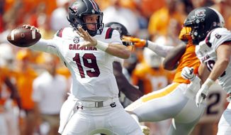 FILE - In this Saturday, Oct. 14, 2017, file photo, South Carolina quarterback Jake Bentley (19) throws a pass in the first half of an NCAA college football game against Tennessee, in Knoxville, Tenn. South Carolina figured to be a work in progress in coach Will Muschamp's second season. But headed into their break, the Gamecocks are among the Southeastern Conference's biggest surprises at 5-2 and have their sights set on even bigger things the rest of the way.  (AP Photo/Wade Payne, File)