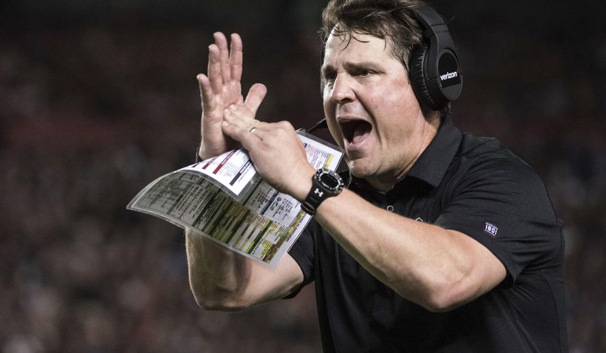 FILE - In this Sept. 16, 2017, file photo, South Carolina head coach Will Muschamp calls for a timeout during the first half of an NCAA college football game against Kentucky in Columbia, S.C. South Carolina figured to be a work in progress in coach Will Muschamp's second season. But headed into their break, the Gamecocks are among the Southeastern Conference's biggest surprises at 5-2 and have their sights set on even bigger things the rest of the way.   (AP Photo/Sean Rayford, File)