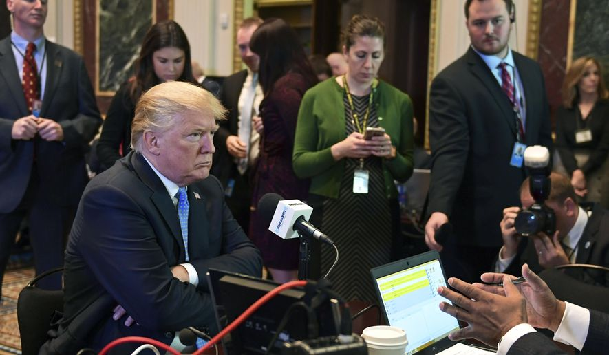 President Donald Trump sits for a radio interview in the Eisenhower Executive Office Building in the White House complex in Washington, Tuesday, Oct. 17, 2017. (AP Photo/Susan Walsh)