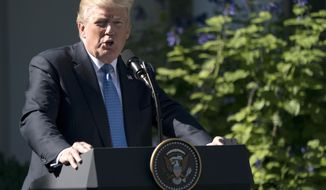 President Donald Trump speaks during anews conference with Greek Prime Minister Alexis Tsipras in the Rose Garden of the White House in Washington, Tuesday, Oct. 17, 2017. Trump on Tuesday will call the families of four soldiers killed this month in Niger, the White House says, as Trump again casts doubt on whether his predecessor appropriately consoled the families of military personnel who died in war. (AP Photo/Carolyn Kaster)