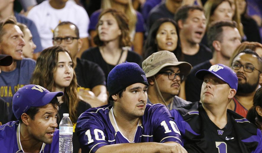Washington fans watch the closing moments of a loss against Arizona State during the second half of an NCAA college football game, Saturday, Oct. 14, 2017, in Tempe, Ariz. Arizona State defeated Washington 13-7. (AP Photo/Ross D. Franklin)