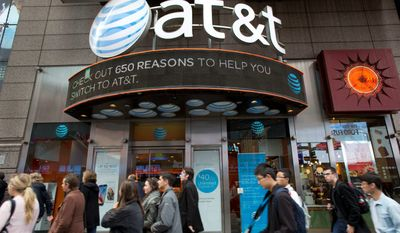 AT&T plans to buy Time Warner for $85.4 billion. (Associated Press)