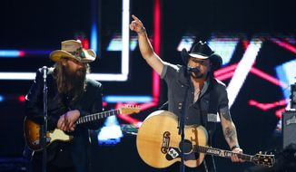Chris Stapelton, left, and Jason Aldean perform at 2017 CMT Artist of the Year Awards at Nashville's Schermerhorn Symphony Center on Wednesday, Oct. 18, 2017, in Nashville, Tenn. (Photo by Wade Payne/Invision/AP)