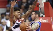 Philadelphia 76ers guard JJ Redick, right, goes to the basket against Washington Wizards forward Kelly Oubre Jr. (12) during the second half of an NBA basketball game, Wednesday, Oct. 18, 2017, in Washington. The Wizards won 120-115. (AP Photo/Nick Wass)