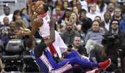 Washington Wizards guard Bradley Beal (3) is fouled by Philadelphia 76ers forward Amir Johnson, bottom, during the second half of an NBA basketball game, Wednesday, Oct. 18, 2017, in Washington. The Wizards won 120-115. (AP Photo/Nick Wass)