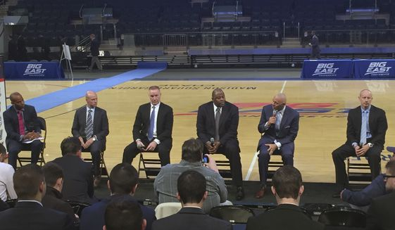 From left to right, moderator Tarik Turner, Seton Hall coach Kevin Willard; St. John's coach Chris Mullin; Georgetown coach Patrick Ewing; DePaul coach Dave Leitao; and Xavier coach Chris Mack chat during Big East NCAA college basketball media day in New York. (AP Photo/Paul Montello)