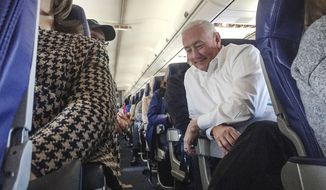 In this Jan. 18, 2017, photo, Greg Pence, a brother of Vice President-elect Mike Pence, sits on his flight from Indianapolis to Washington, D.C. Greg Pence filed a tax document indicating he will seek the eastern Indiana congressional seat that the vice president and former governor represented for 12 years. (Jenna Watson/The Indianapolis Star via AP)