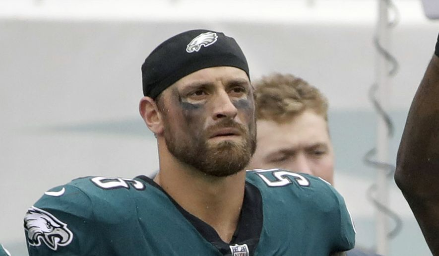 """FILE - In this Oct. 8, 2017, file photo, Philadelphia Eagles' Chris Long (56) is shown during the National Anthem before an NFL football game against the Arizona Cardinals in Philadelphia.  Long is donating the rest of his year's salary to increase educational equality. The Eagles' defensive end already gave up his first six game checks to provide two scholarships for students in Charlottesville, Virginia. Now, he's using the next 10 to launch the Pledge 10 for Tomorrow campaign. """"My wife and I have been passionate about education being a gateway for upward mobility and equality,"""" Long told The Associated Press. (AP Photo/Matt Rourke, File)"""
