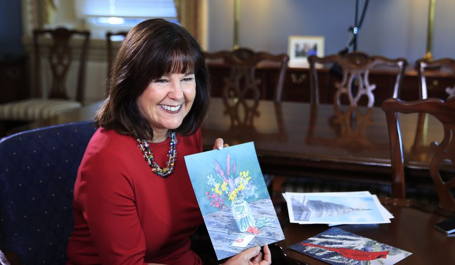 Karen Pence, wife of Vice President Mike Pence, shows her artwork during an interview with The Associated Press in her office at the Eisenhower Executive Office Building on the White House complex in Washington, Tuesday, Oct. 17, 2017. Pence is using her platform as the vice president's wife to raise awareness about art therapy, a mental health field she's been passionate about for a decade but says is unknown to many. (AP Photo/Manuel Balce Ceneta)
