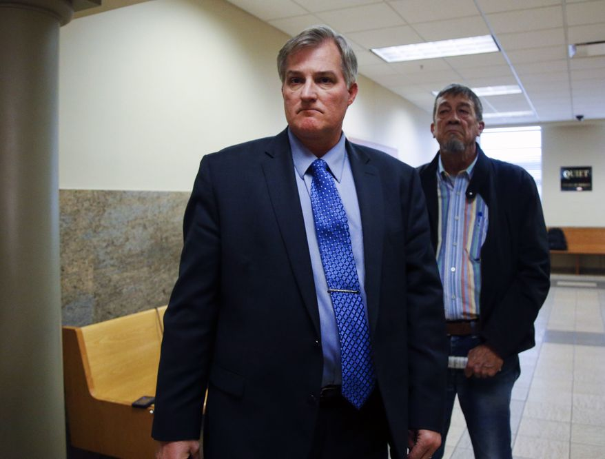 Former Tulsa officer Shannon Kepler walks out of the courtroom as the jury leaves to deliberate on his fourth court case and fourth murder charge at the Tulsa County Courthouse on Wednesday Oct. 18, 2017. Kepler, on trial for the fourth time in the 2014 killing of his daughter's black boyfriend, told jurors he had no choice but to shoot the young man. (Jessie Wardarski/Tulsa World via AP)