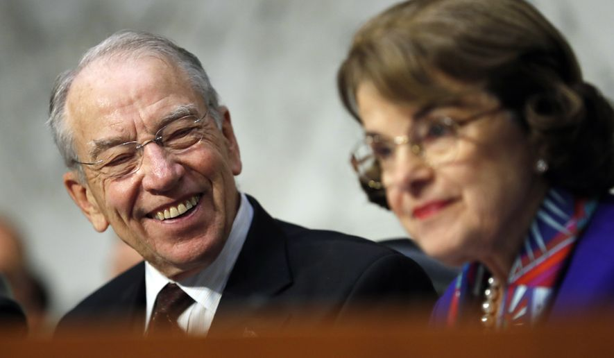 Senate Judiciary Committee Chairman Chuck Grassley, R-Iowa, left, looks to ranking member Sen. Dianne Feinstein, D-Calif., as Attorney General Jeff Sessions testifies before the Senate Judiciary Committee on Capitol Hill in Washington, Wednesday, Oct. 18, 2017. (AP Photo/Carolyn Kaster)