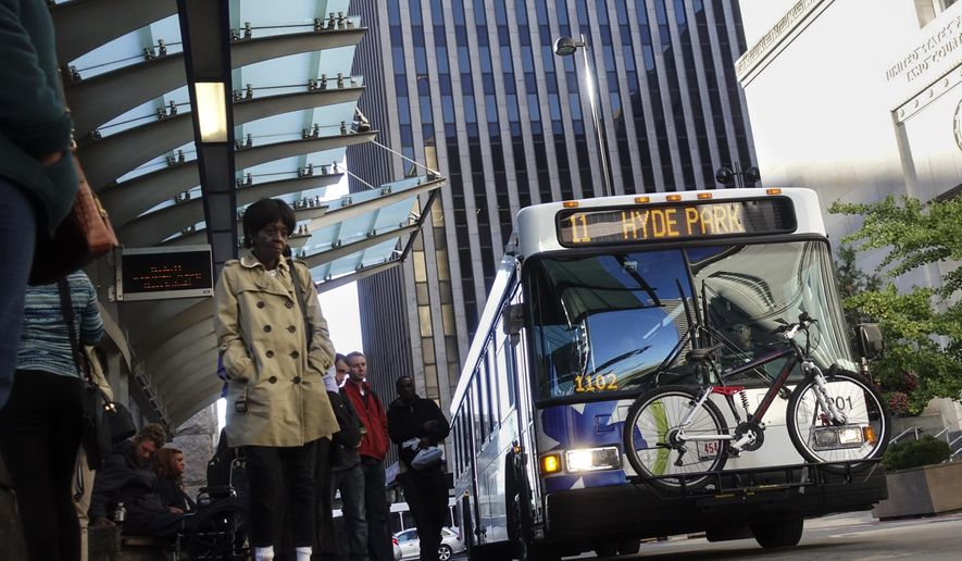 In this Tuesday, Oct. 17, 2017, photo, commuters use public transportation during the evening rush hour in Cincinnati. Ohio and its major cities are vying with competitors from across the country salivating over the potential boost of hosting Amazon's upcoming second headquarters and some 50,000 workers. The Seattle-based company has invited bids that are due Thursday, Oct. 19. (AP Photo/John Minchillo)