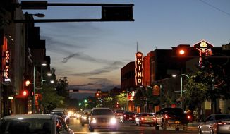 FILE - In this June 21, 2016, file photo, cars make their way along historic Route 66 in downtown Albuquerque, N.M. Albuquerque is one of the cities wooing Amazon to build their second headquarters in their area. (AP Photo/Susan Montoya Bryan, File)