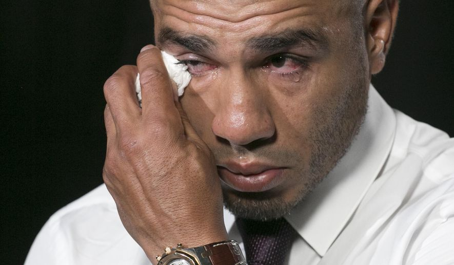 Boxer Miguel Cotto wipes away tears during an interview, Tuesday, Oct. 17, 2017, in New York. Cotto will bid farewell to the ring after facing Sadam Ali in a junior middleweight bout on Dec. 2 at Madison Square Garden. (AP Photo/Mark Lennihan)