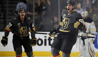 Vegas Golden Knights left wing David Perron celebrates after making the game-winning goal during overtime of an NHL hockey game against the Buffalo Sabres, Tuesday, Oct. 17, 2017, in Las Vegas. (AP Photo/John Locher)