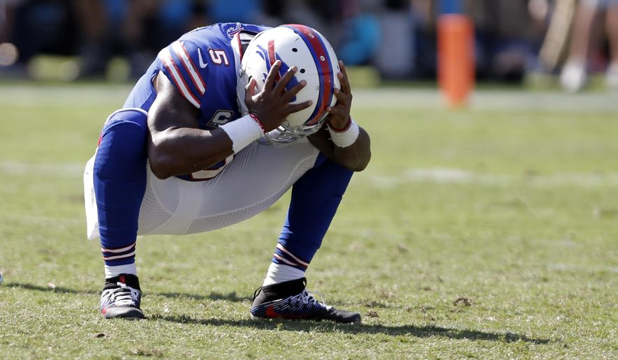 FILE - In this Sept. 17, 2017, file photo, Buffalo Bills' Tyrod Taylor reacts to an incomplete pass on fourth down in the final seconds in the second half of an NFL football game against the Carolina Panthers in Charlotte, N.C. In his third season as the Bills starter, Taylor has yet to prove he's capable of rallying the team once it falls behind by more than a field goal. Buffalo comes out of its bye preparing to host Tampa Bay on Sunday. ((AP Photo/Bob Leverone, File)