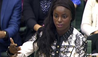 Footballer Eniola Aluko answers questions in front of the Digital, Culture, Media and Sport Committee at Portcullis House in Westminster, London, Wednesday, Oct. 18, 2017. A fresh investigation into the conduct of fired national women's team coach Mark Sampson found that he directed discriminatory comments at players Eniola Aluko and Drew Spence, the English Football Association said Wednesday. (PA via AP)