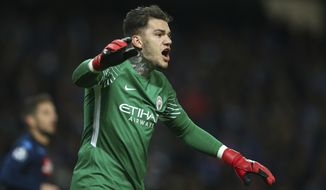 Manchester City goalkeeper Ederson celebrates after saving a penalty kick during the Champions League group F soccer match between Manchester City and Napoli at the Etihad Stadium in Manchester, England, Tuesday, Oct.17, 2017. (AP Photo/Dave Thompson)