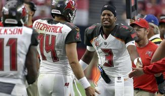 FILE - In this Oct. 15, 2017, file photo, Tampa Bay Buccaneers quarterback Jameis Winston (3) congratulates backup quarterback Ryan Fitzpatrick during an NFL football game against the Arizona Cardinals, Sunday, in Glendale, Ariz. With Winston's status uncertain because of an injured throwing shoulder, the Buccaneers begin preparation for the Buffalo Bills with Fitzpatrick at quarterback. (AP Photo/Rick Scuteri, File)