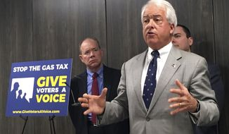 "California Republican gubernatorial candidate John Cox, right, speaks in Sacramento, Calif., Wednesday, Oct. 18, 2017, about his decision to spend ""significant"" money on an effort to repeal California's newly passed gas and diesel tax increase. Cox is joined by Jon Coupal, president of the Howard Jarvis Taxpayers Association, at left. (AP Photo/Kathleen Ronayne)"