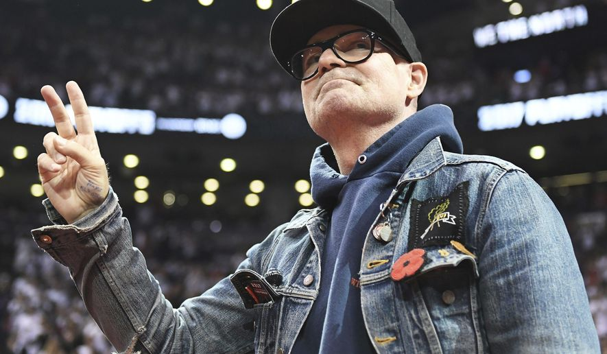 FILE - In this May 5, 2017 file photo, lead singer of The Tragically Hip Gord Downie salutes fans during the first half of Game 3 of an NBA basketball second-round playoff series between the Toronto Raptors and the Cleveland Cavaliers in Toronto. The widely revered lead singer died Tuesday night, Oct. 17, 2017. He was 53.  (Frank Gunn/The Canadian Press via AP File)