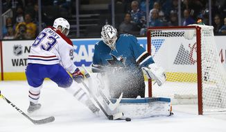 San Jose Sharks goalie Martin Jones (31) blocks a goal attempt by Montreal Canadiens right wing Ales Hemsky (83), of the Czech Republic, during the second period of an NHL hockey game, Tuesday, Oct. 17, 2017, in San Jose, Calif. (AP Photo/Tony Avelar)
