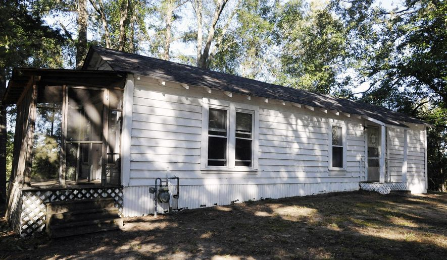 A house said to be a boyhood home of singer Elvis Presley is pictured in Tupelo, Miss., on Tuesday, Oct. 17, 2017. The house and more than 16 acres of adjoining property are part of an online celebrity auction set for Nov. 11. The home is located atop a hill near the elementary school that Presley attended. (AP Photo/Jay Reeves)