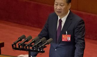 Chinese President Xi Jinping delivers a speech at the opening ceremony of the 19th Party Congress held at the Great Hall of the People in Beijing, China, Wednesday, Oct. 18, 2017. Having bested his rivals, Xi is primed to consolidate his already considerable power as the ruling Communist Party begins its twice-a-decade national congress on Wednesday. (AP Photo/Ng Han Guan)