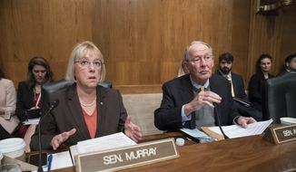Sen. Patty Murray, D-Wash., the ranking member, and Sen. Lamar Alexander, R-Tenn., chairman of the Senate Health, Education, Labor, and Pensions Committee, meet before the start of a hearing on Capitol Hill in Washington, Wednesday, Oct. 18, 2017. (AP Photo/J. Scott Applewhite) ** FILE **