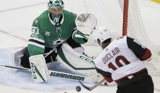 Dallas Stars goalie Ben Bishop (30) defends the goal against Arizona Coyotes left wing Anthony Duclair (10) during the third period of an NHL hockey game in Dallas, Tuesday, Oct. 17, 2017. The Stars won 3-1. (AP Photo/LM Otero)
